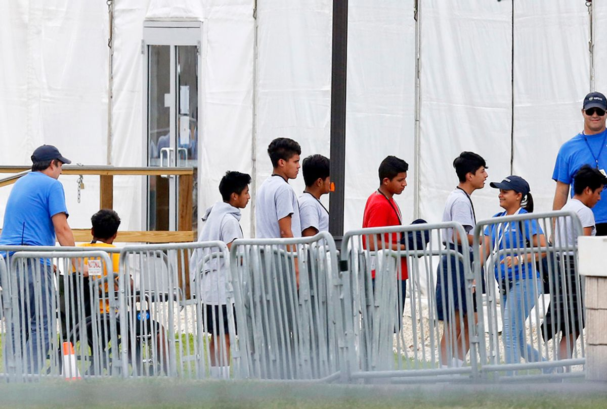 Immigrant children walk in outside the Homestead Temporary Shelter for Unaccompanied Children in Homestead, Fla. (AP/Brynn Anderson)