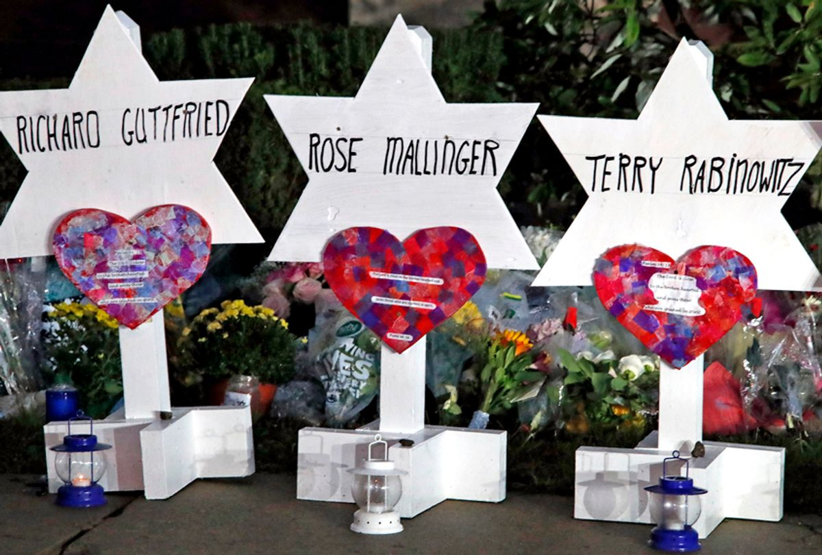 This photo shows some of Stars of David with names of those killed at the Tree of Life Synagogue in Pittsburgh in Saturday's shooting, at a memorial outside the synagogue, Sunday, Oct. 28, 2018. (AP/Gene J. Puskar)