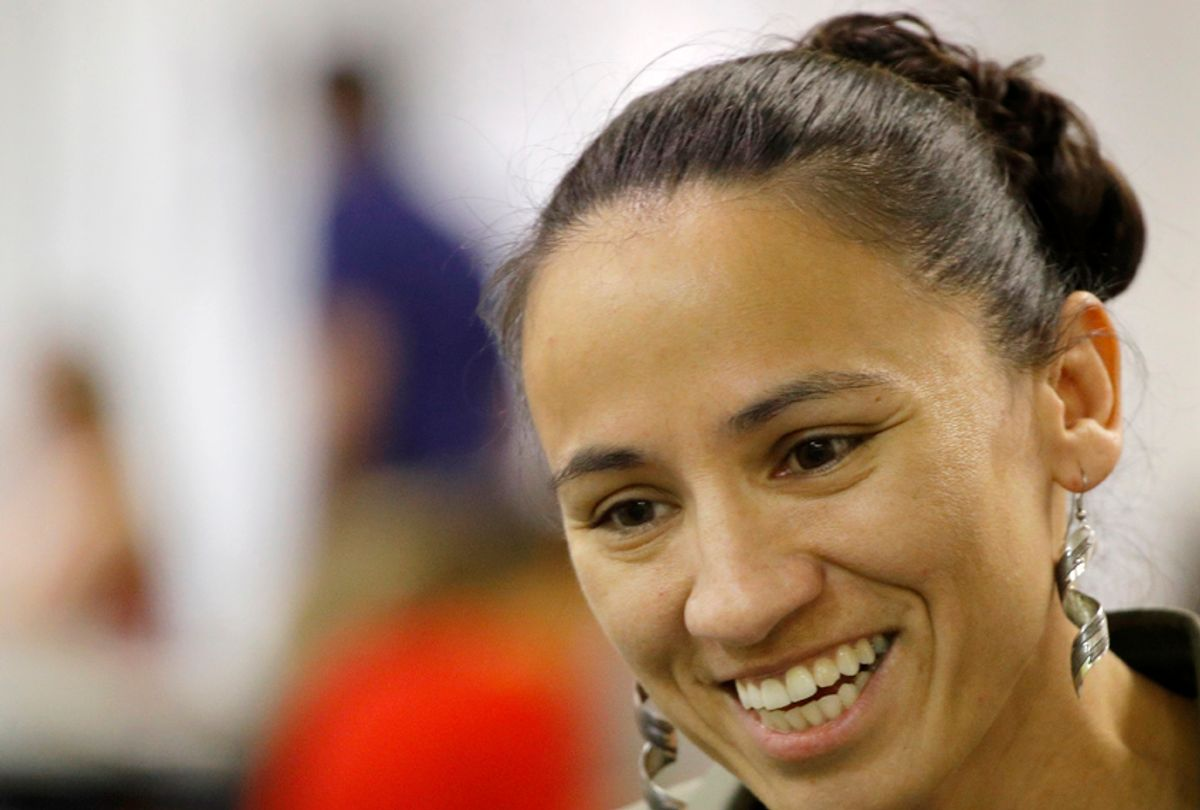 Democratic Congressional candidate Sharice Davids talks to volunteer at her campaign office Monday, Oct. 1, 2018, in Overland Park, Kan. Davids is challenging Republican incumbent Kevin Yoder in Kansas' 3rd District. (AP Photo/Charlie Riedel) (AP)