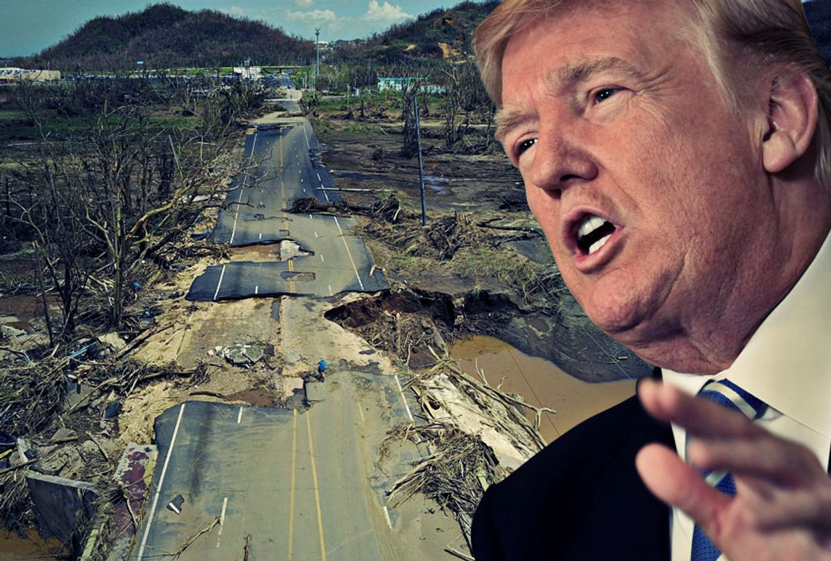 A man rides his bicycle through a damaged road in Toa Alta, Puerto Rico, on September 24, 2017 following the passage of Hurricane Maria. (Getty/Salon)
