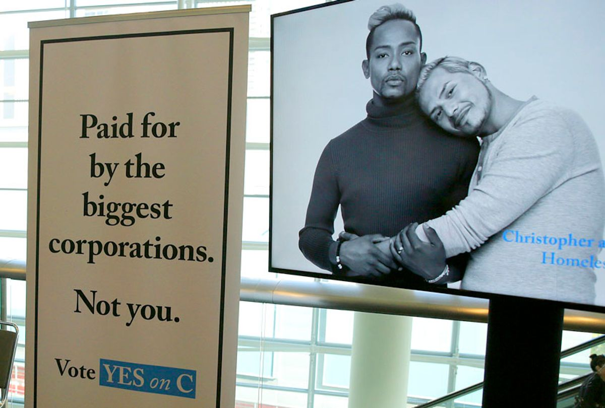 Signs urge support for Proposition C at a SPUR luncheon in San Francisco. (AP/Eric Risberg)