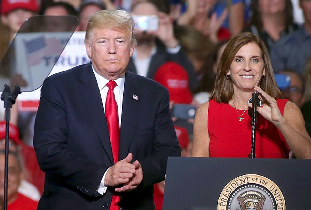 Donald Trump and Martha McSally during a rally at the International Air Response facility on October 19, 2018 in Mesa, Arizona. (Getty/Ralph Freso)