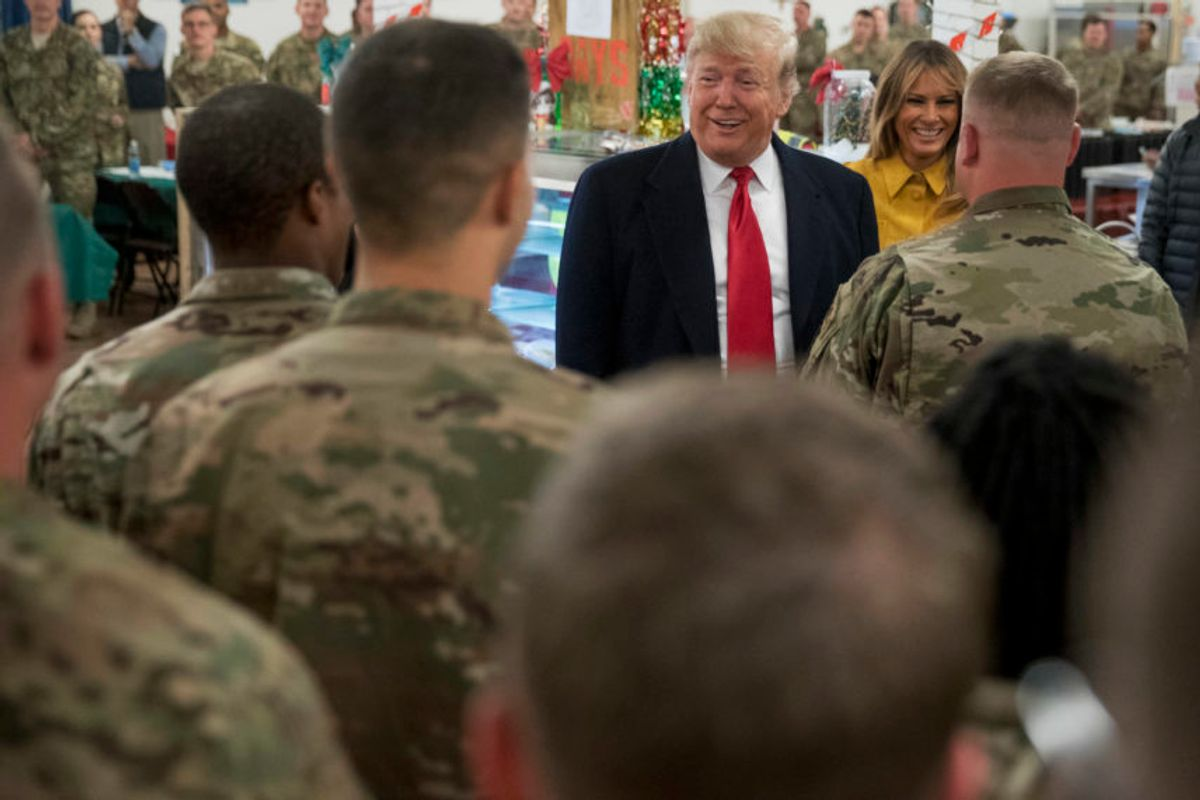 President Donald Trump and first lady Melania Trump visit with members of the military at a dining hall at Al Asad Air Base, Iraq, Wednesday, Dec. 26, 2018. (AP Photo/Andrew Harnik) (AP)