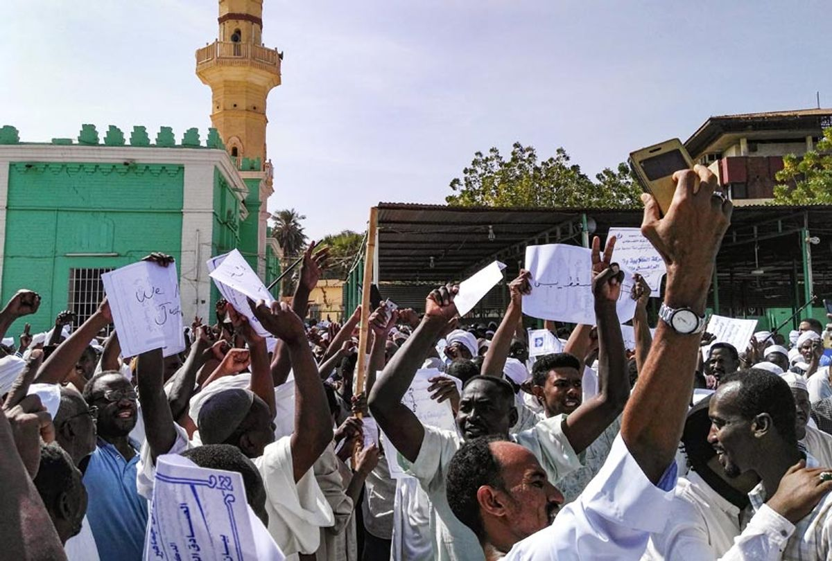 Sudanese protesters chant slogans and raise signs against President Omar al-Bashir during a demonstration in the capital Khartoum's twin city of Omdurman on January 25, 2019. (-/AFP/Getty Images)