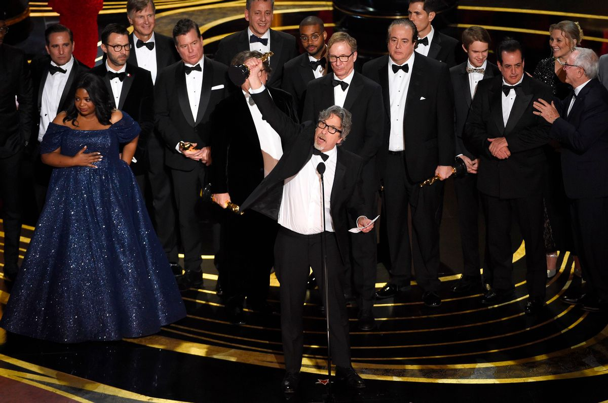 """Peter Farrelly, center, and the cast and crew of """"Green Book"""" accept the award for best picture at the Oscars. (Chris Pizzello/Invision/AP)"""