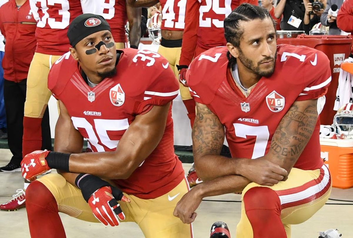 Eric Reid and Colin Kaepernick of the San Francisco 49ers kneel in protest during the national anthem. (Getty/Thearon W. Henderson)