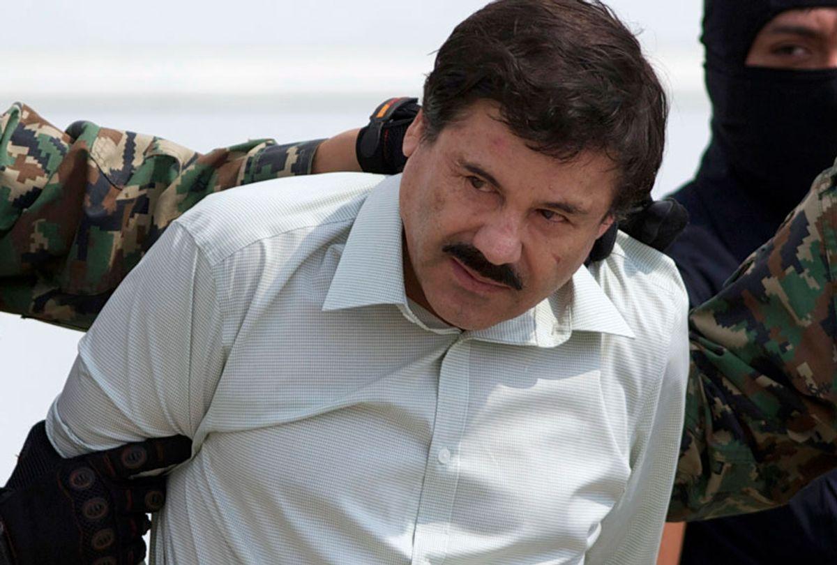 "This Feb. 22, 2014 file photo shows Joaquin ""El Chapo"" Guzman, the head of Mexico's Sinaloa Cartel, being escorted to a helicopter in Mexico City. (AP/Eduardo Verdugo)"