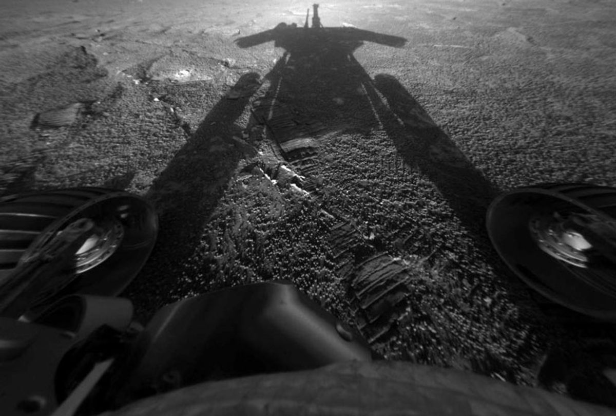 The shadow of the Mars Exploration Rover Opportunity as it traveled farther into Endurance Crater in the Meridiani Planum region of Mars (NASA/JPL-Caltech via AP)