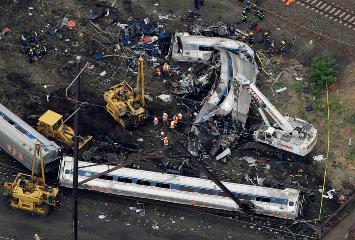emergency personnel work at the scene of a deadly train derailment in Philadelphia, May 13, 2015. (AP/Patrick Semansky)