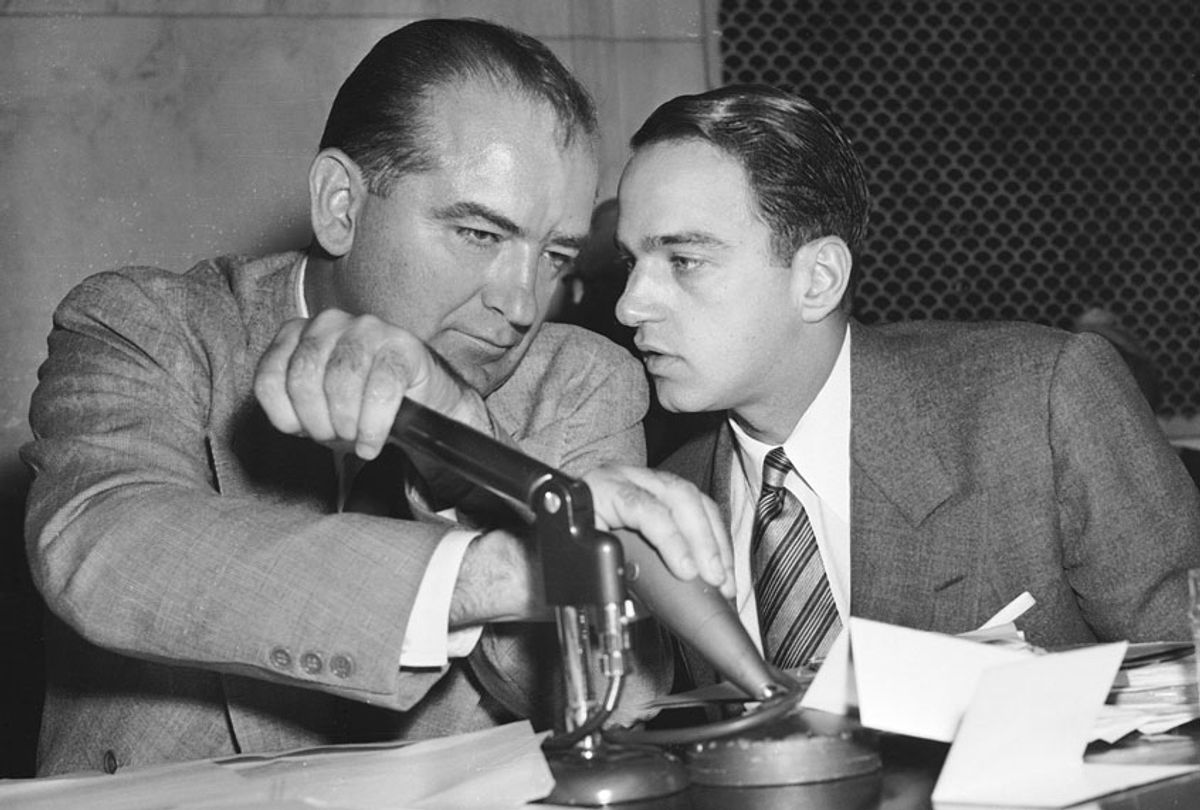 Senator Joseph McCarthy has a whispered discussion with Roy Cohn during a committee hearing on April 26, 1954, in Washington. (AP Photo)