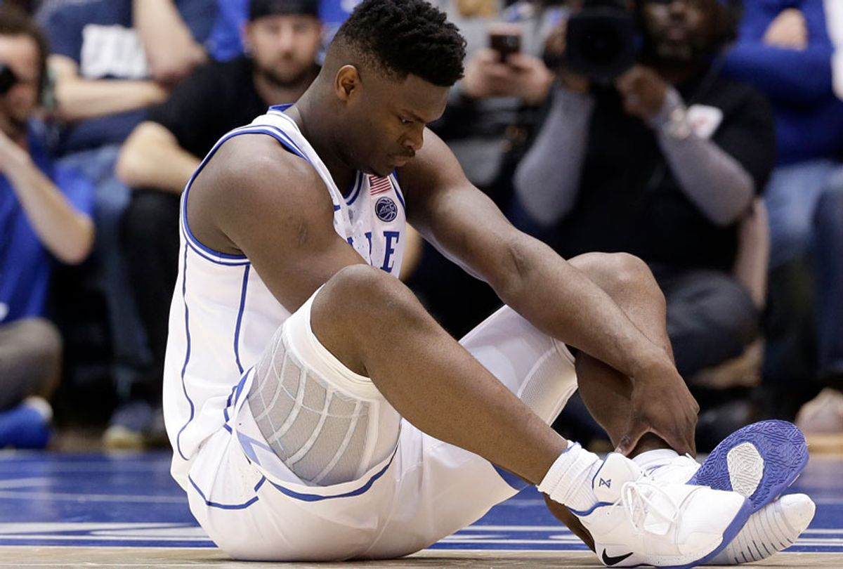 Duke's Zion Williamson sits on the floor following a injury during the first half of an NCAA college basketball game against North Carolina in Durham, N.C., Wednesday, Feb. 20, 2019. (AP/Gerry Broome)