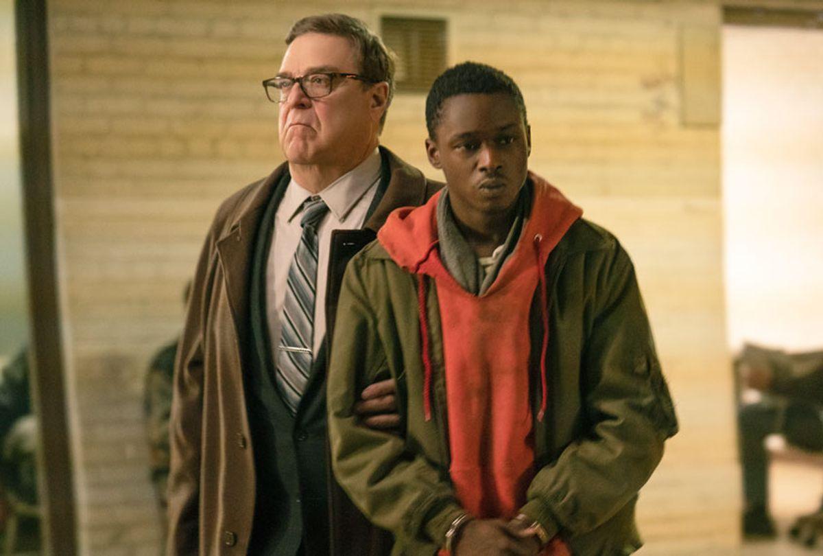 "John Goodman and Ashton Sanders in ""Captive State"" (Parrish Lewis/Focus Features)"