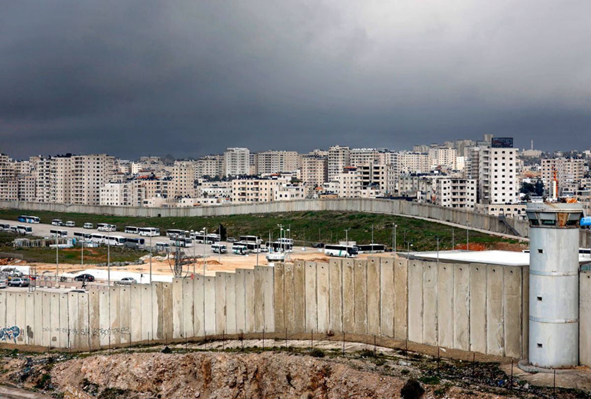 This picture taken on January 17, 2019 from the Palestinian West Bank village of Al-Ram shows the controversial Israeli separation barrier separating East Jerusalem  and the Palestinian West Bank town of Qalandia. (Getty/Thomas Coex)