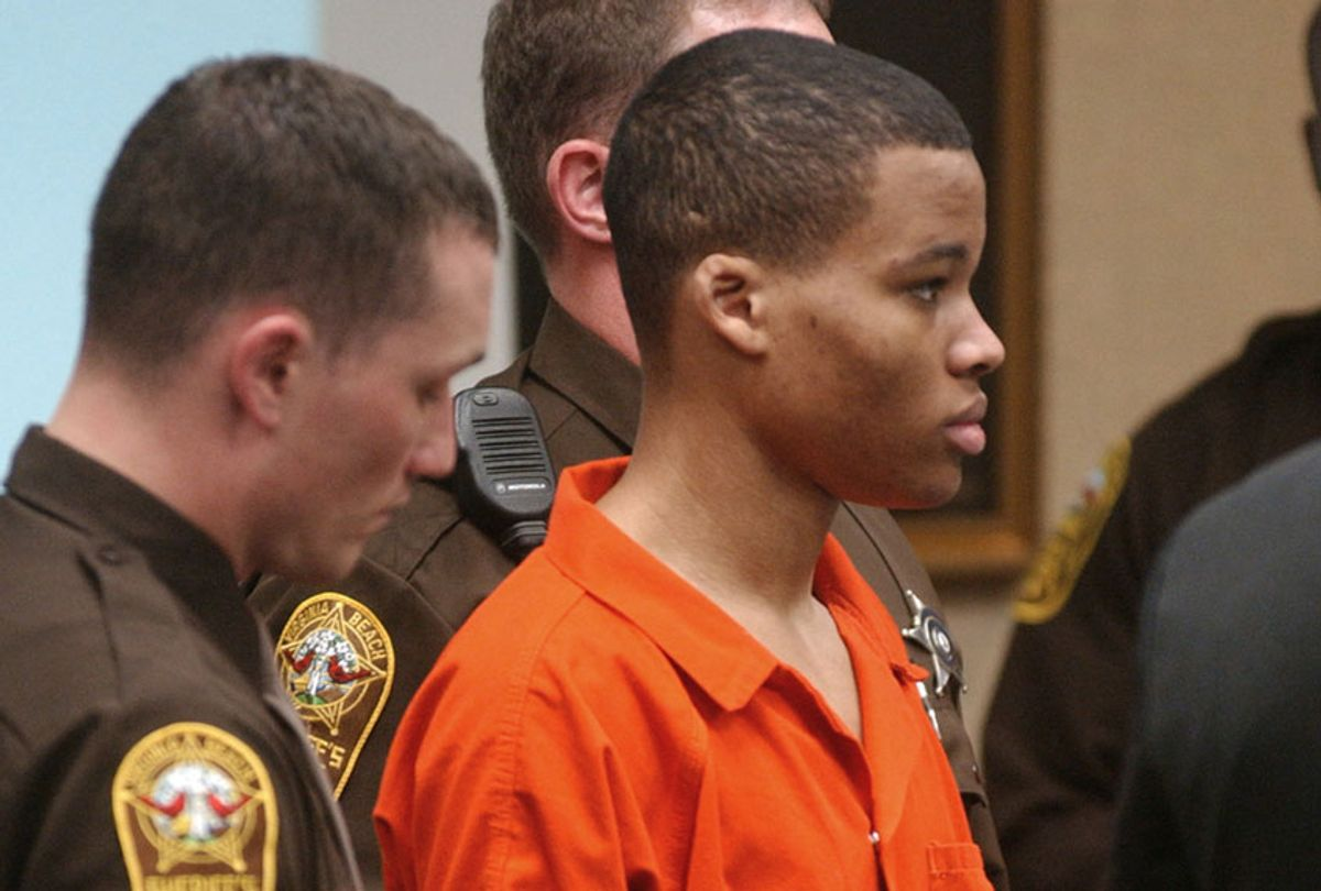 Lee Boyd Malvo listens to court proceedings during the trial of fellow sniper suspect John Allen Muhammad in Virginia Beach, Va., Oct. 20, 2003. (AP/Martin Smith-Rodden)