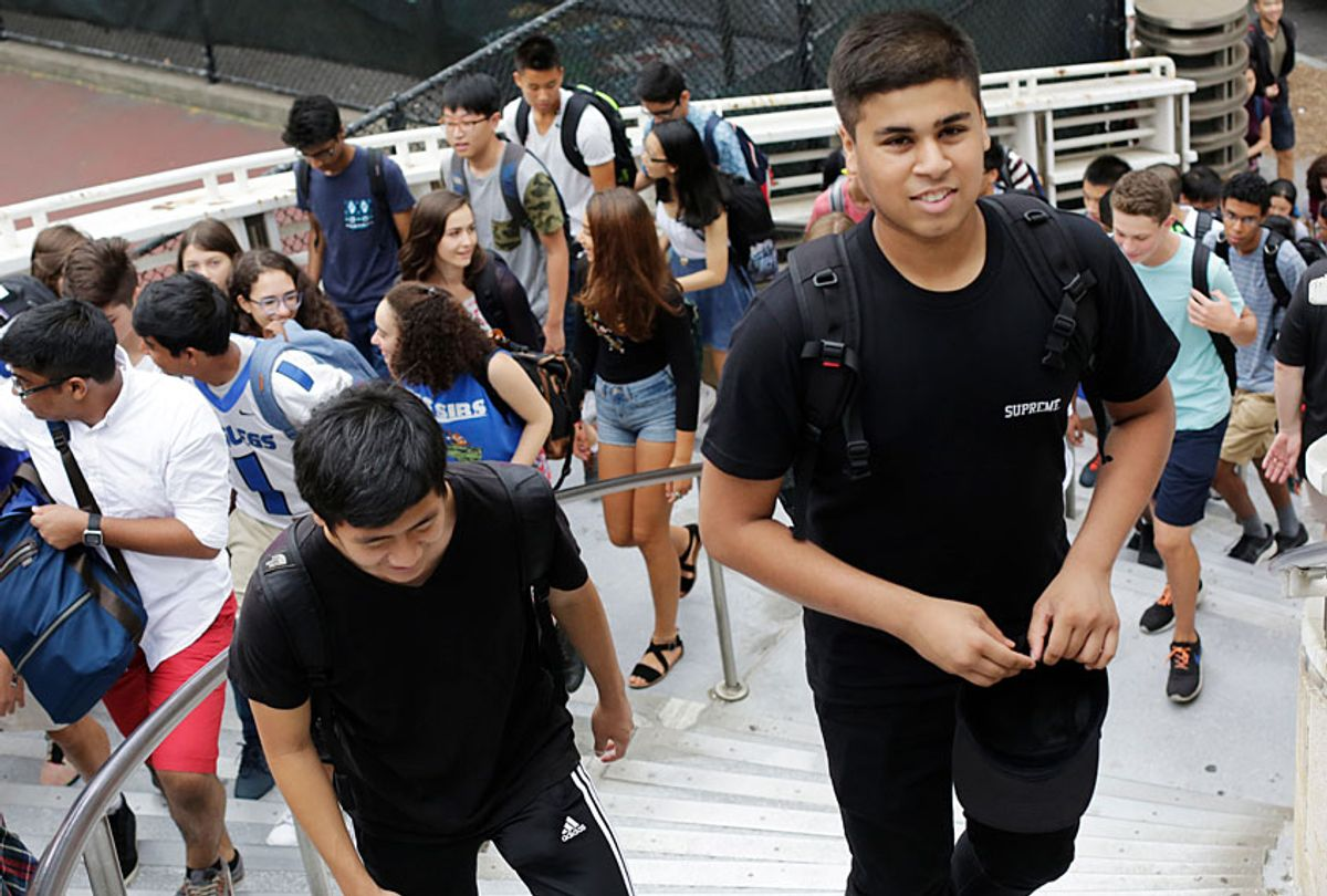 Students arrive for the first day of school at Stuyvesant High School, Wednesday, Sept. 9, 2015 in New York. (AP/Mark Lennihan)