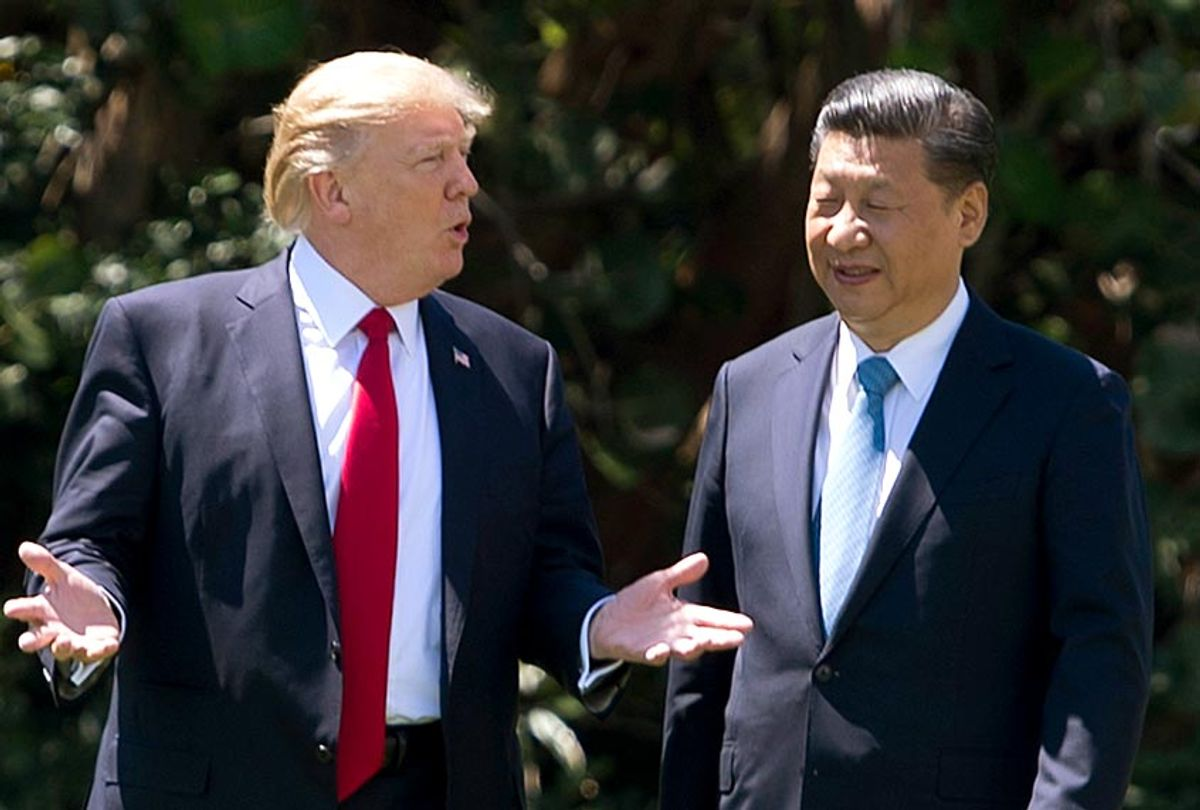 Donald Trump and Chinese President Xi Jinping walk together at the Mar-a-Lago estate in West Palm Beach, Florida, April 7, 2017. (Getty/Jim Watson)