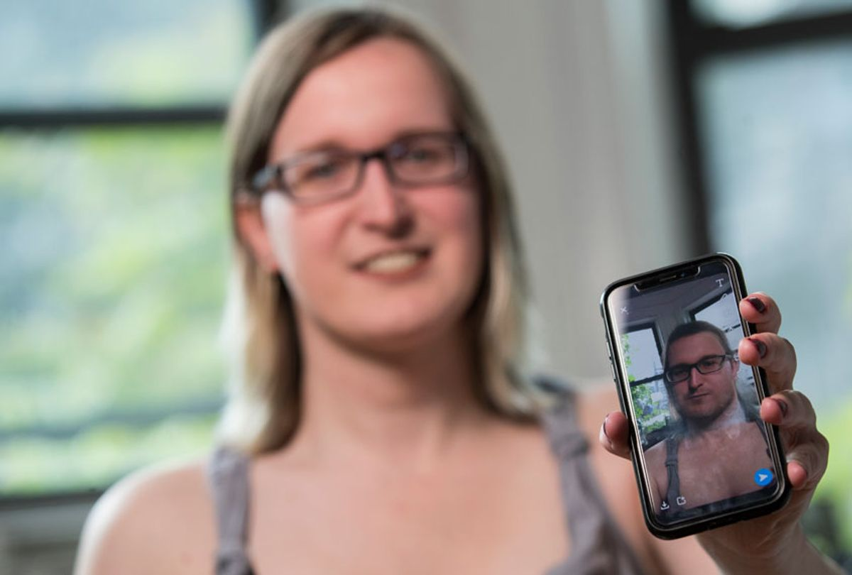 In this Wednesday, May 15, 2019, photo, Bailey Coffman shows her photo as a man in the Snapchat app during an interview in New York. (AP/Mary Altaffer)