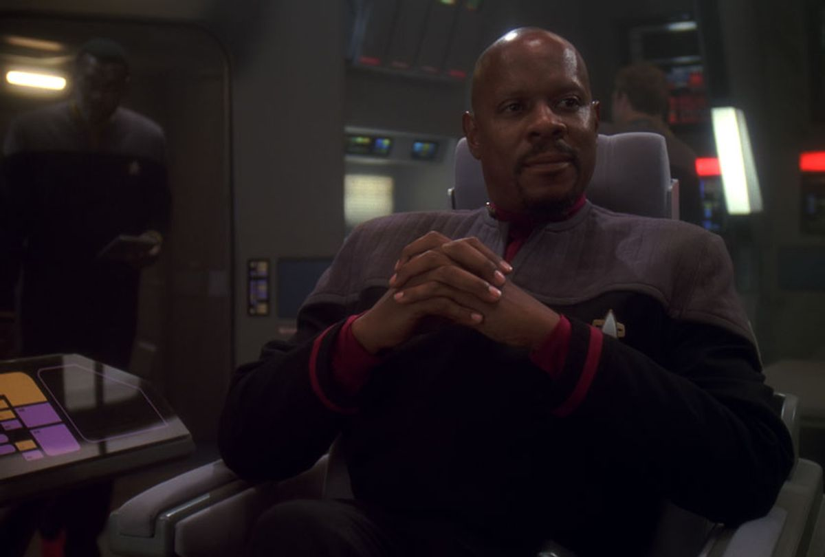 "Avery Brooks as 'Captain Benjamin Sisko' sits on the bridge of the Defiant. (""Star Trek"" footage and photos courtesy of CBS Television Studios)"