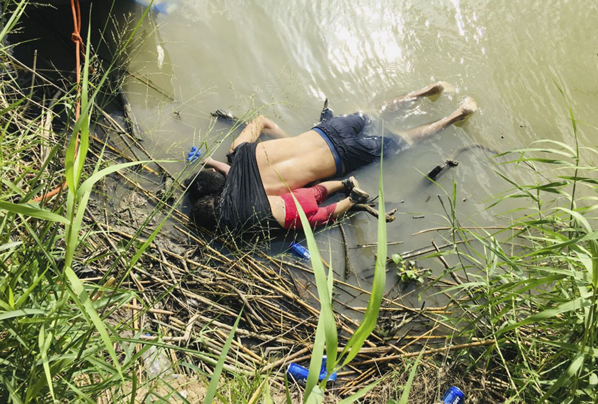 The bodies of Salvadoran migrant Oscar Alberto Martínez Ramírez and his nearly 2-year-old daughter Valeria lie on the bank of the Rio Grande in Matamoros, Mexico, Monday, June 24, 2019, after they drowned trying to cross the river to Brownsville, Texas. (AP/Julia Le Duc)