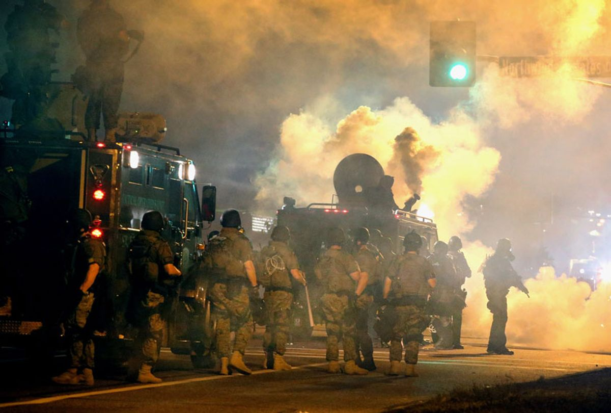 Police attempt to control demonstrators protesting the killing of teenager Michael Brown on August 18, 2014 in Ferguson, Missouri.  (Getty/Scott Olson)