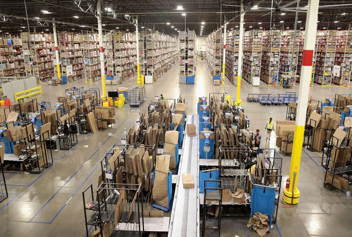 Workers pack and ship customer orders at the 750,000-square-foot Amazon fulfillment center on August 1, 2017 in Romeoville, Illinois. (Getty/Scott Olson)