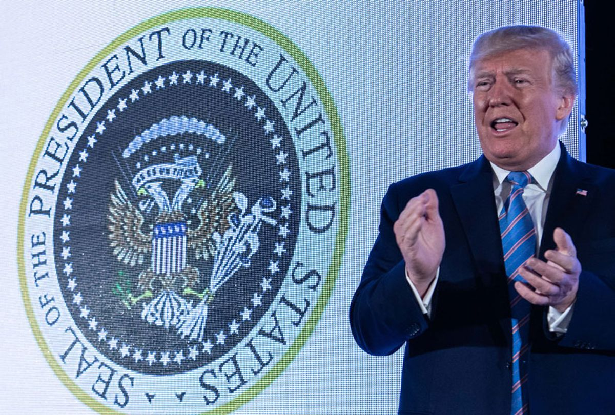 U.S. President Donald Trump stands next to a surreptitiously altered presidential seal as he arrives to address the Turning Point USAs Teen Student Action Summit 2019 in Washington, DC, on July 23, 2019. (Getty/Nicholas Kamm)