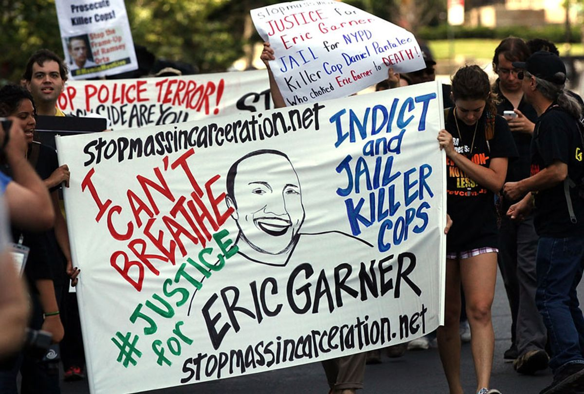 People protest in Staten Island on the one year anniversary of the death of Eric Garner on July 17, 2015 in New York City.  (Getty/Spencer Platt)