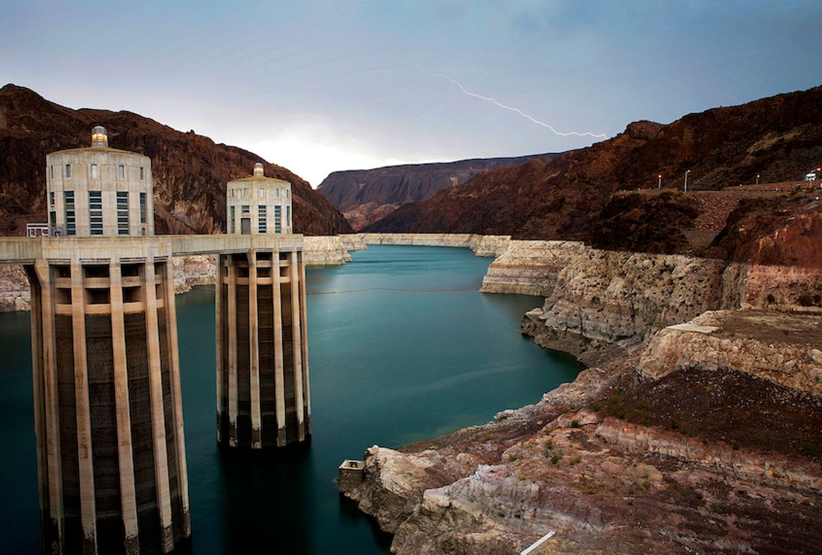 FILE - In this July 28, 2014, file photo, lightning strikes over Lake Mead near Hoover Dam that impounds Colorado River water at the Lake Mead National Recreation Area in Arizona. President Donald Trump on Tuesday, April 16, 2019, signed a plan to cut back on the use of water from the Colorado River, which serves 40 million people in the U.S. West. (AP Photo/John Locher, File) (AP Photo/John Locher, File)