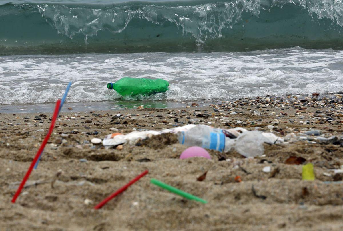 Plastic garbage lying on the Aegean sea beach near Athens on June 26, 2018 , Greece. (Getty/Milos Bicanski)