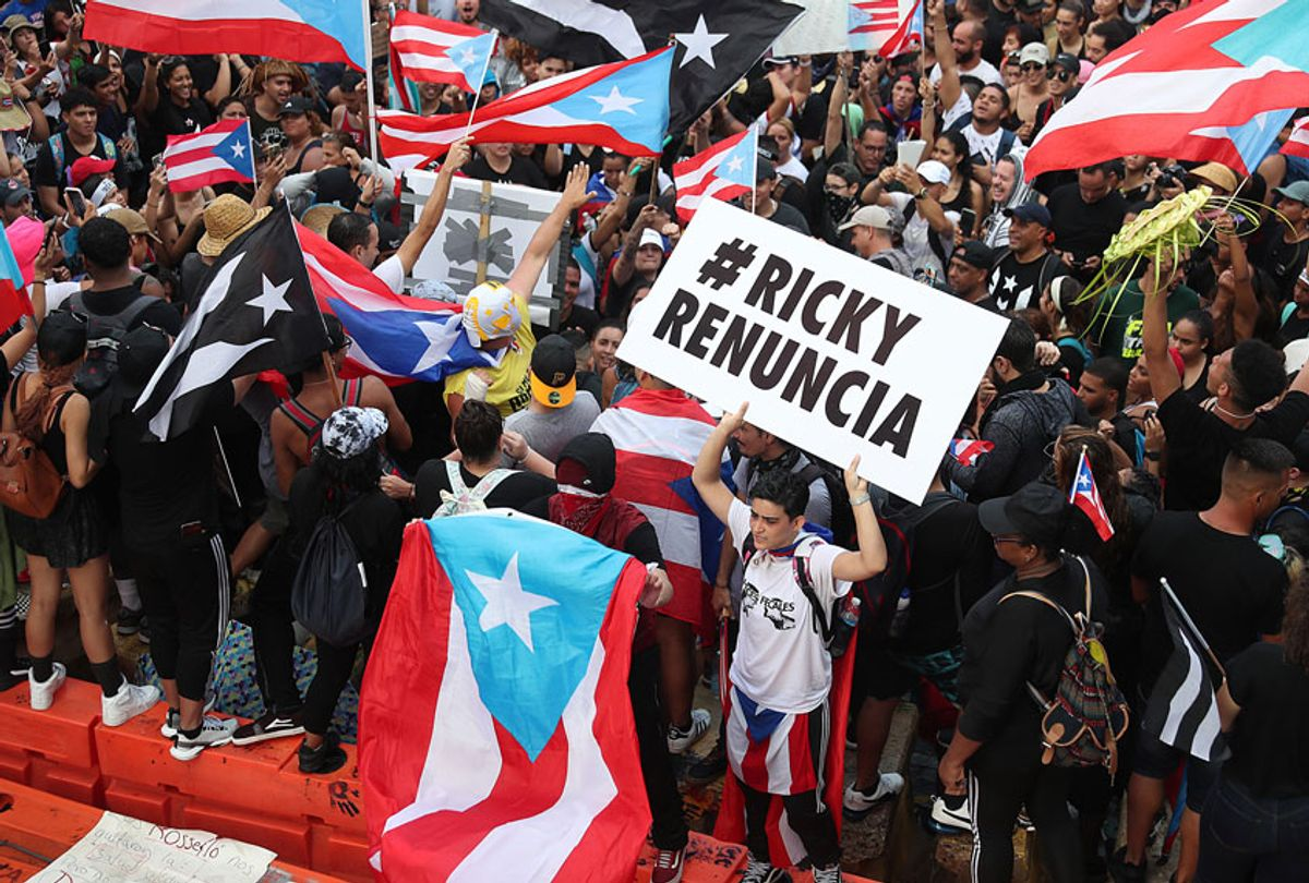 Protesters demonstrate against Ricardo Rossello, the Governor of Puerto Rico, near police that are manning a barricade set up along a street leading to the governor's mansion on July 22, 2019 in Old San Juan, Puerto Rico.  (Getty/Joe Raedle)