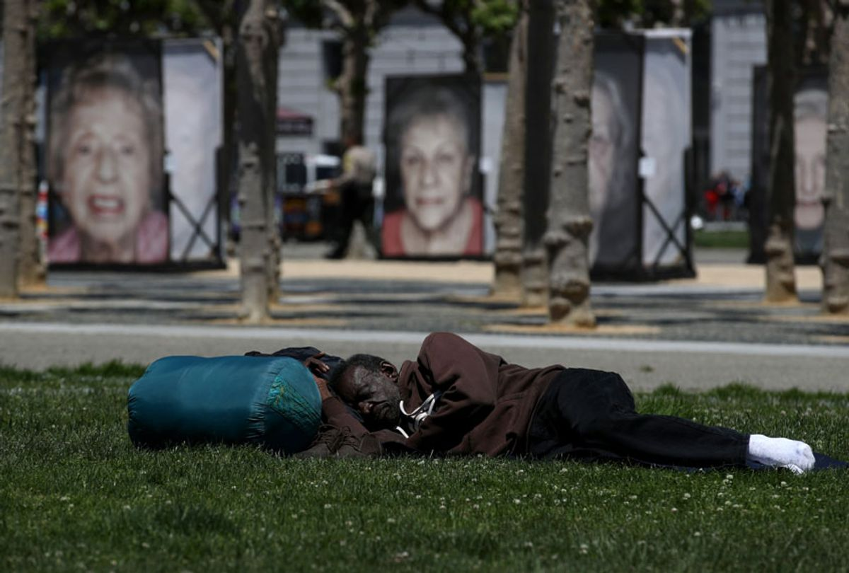 A homeless man sleeps on the grass at Civic Center Plaza on May 17, 2019 in San Francisco, California.  (Getty/Justin Sullivan)