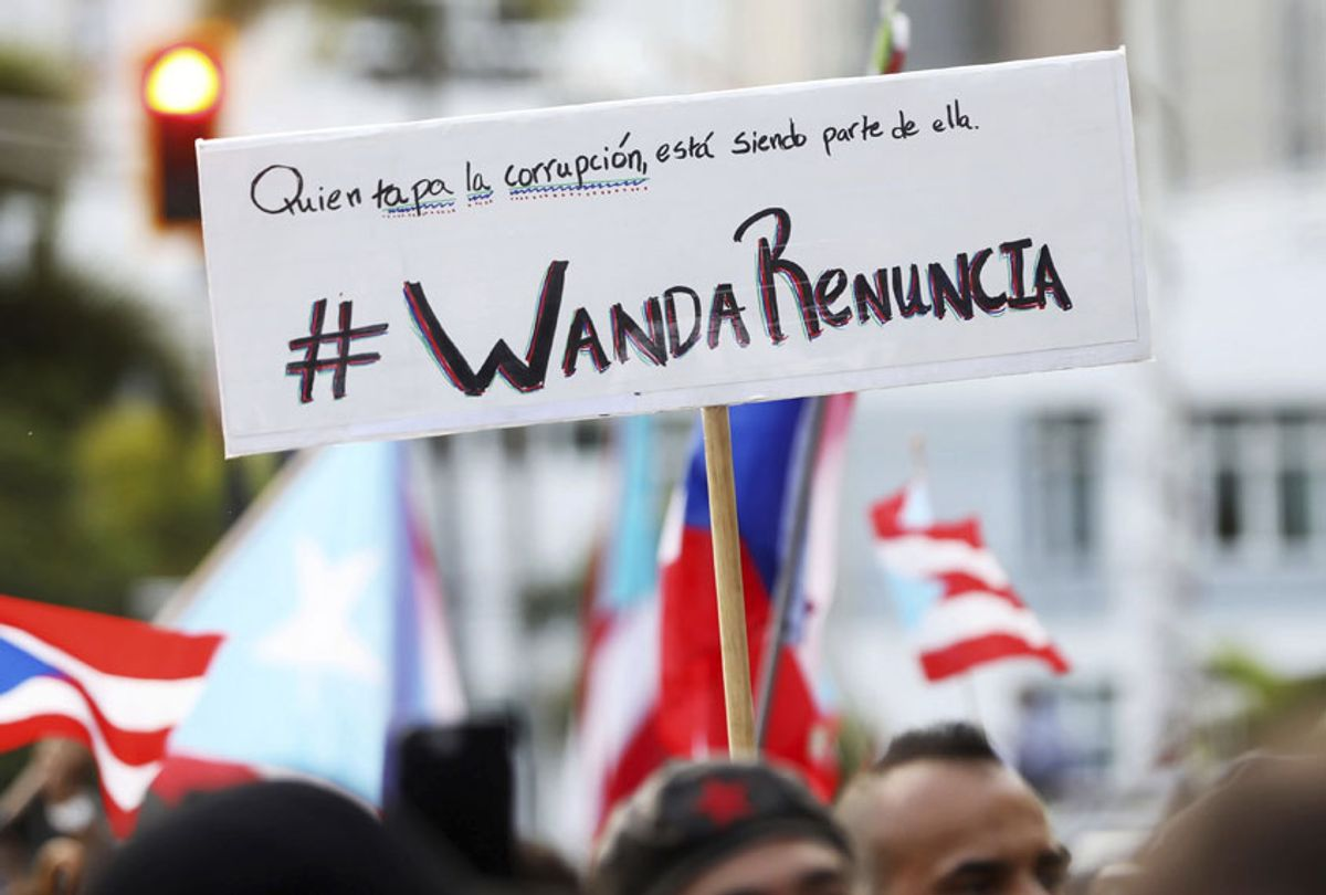 People demand the resignation of Justice Secretary Wanda Vazquez during a protest outside the Department of Justice in San Juan, Puerto Rico, Monday, July 29, 2019.  (AP/Brandon Cruz González)