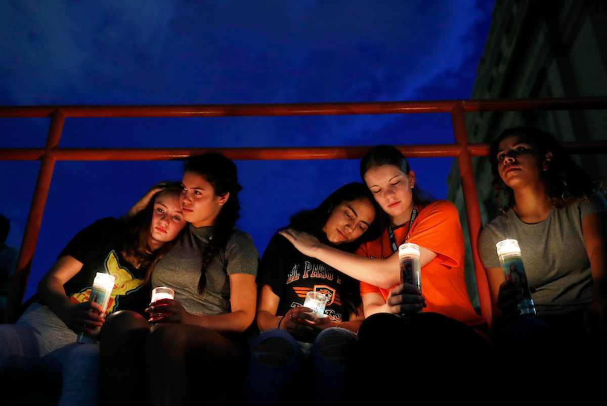 From left, Melody Stout, Hannah Payan, Aaliyah Alba, Sherie Gramlich and Laura Barrios comfort each other during a vigil for victims of the shooting Saturday, Aug. 3, 2019, in El Paso, Texas.  (AP/John Locher)
