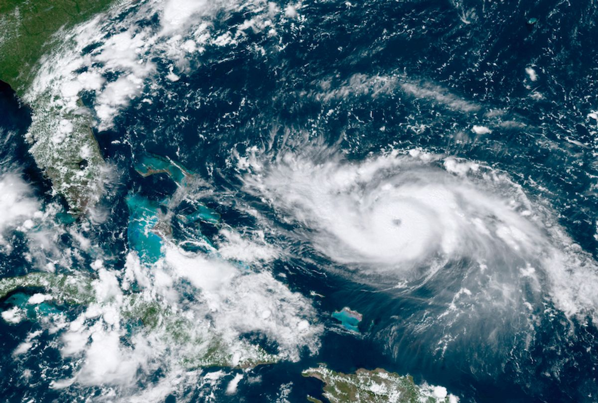 This GOES-16 satellite image taken Friday, Aug. 30, 2019, at 17:20 UTC and provided by National Oceanic and Atmospheric Administration (NOAA), shows Hurricane Dorian, right, moving over open waters in the Atlantic Ocean. Forecasters are now saying Dorian could be a Category 4 with winds of nearly 140 mph (225 kph) when it is forecasted to hit Florida late Monday or early Tuesday. It's also imperiling the Bahamas, where the storm is expected to hit by Sunday. (NOAA via AP) (AP)