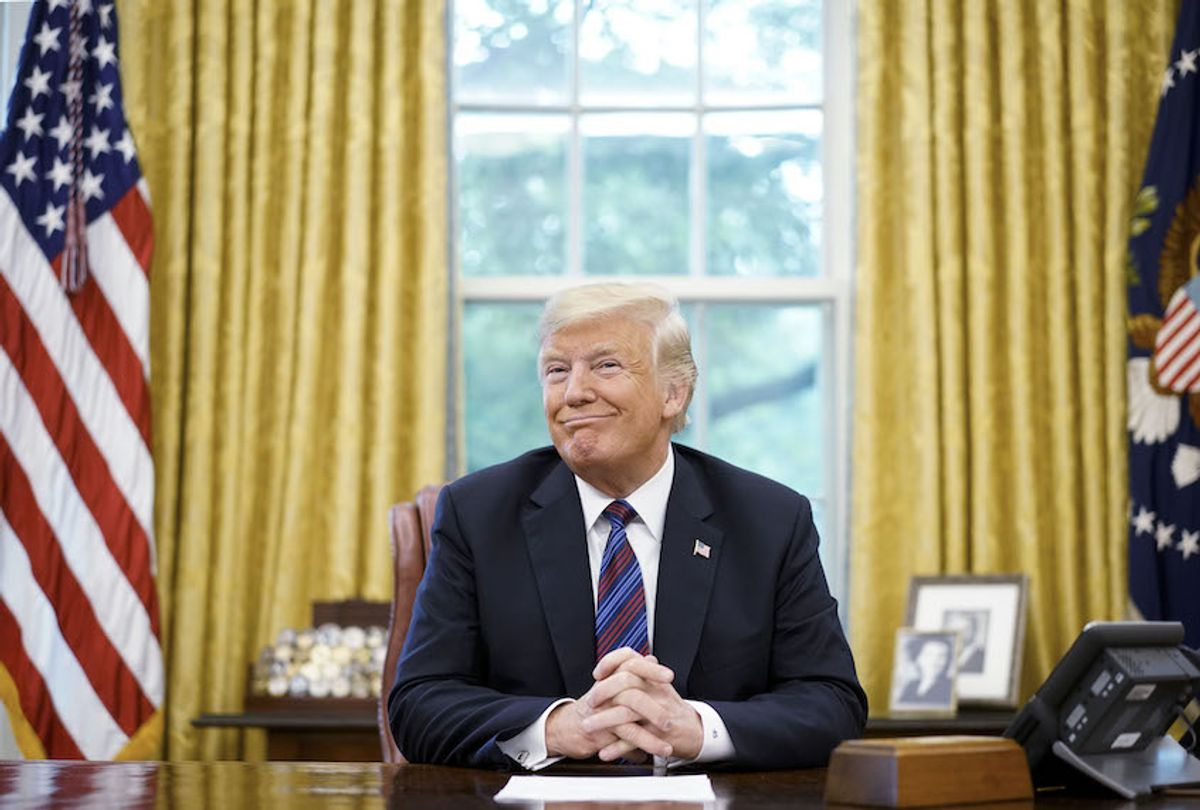 US President Donald Trump smiles during a phone conversation with Mexico's President Enrique Pena Nieto on trade in the Oval Office of the White House in Washington, DC on August 27, 2018. (Mandel Ngan/AFP/Getty Images)
