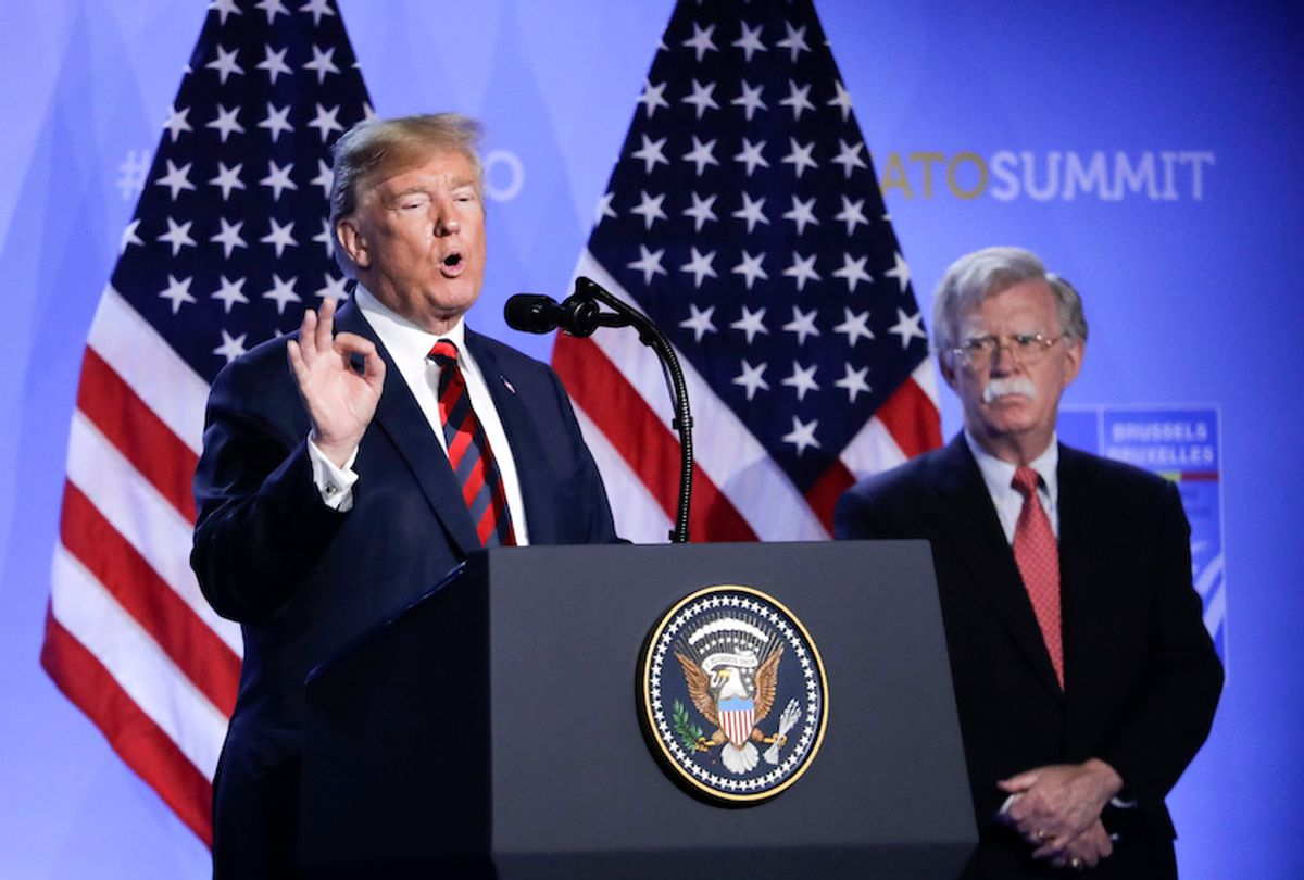 U.S. President Donald Trump, left, is flanked by national security adviser John Bolton, right during a press conference after a summit of heads of state and government at NATO headquarters in Brussels, Belgium, Thursday, July 12, 2018 (AP Photo/Markus Schreiber) (AP Photo/Markus Schreiber)