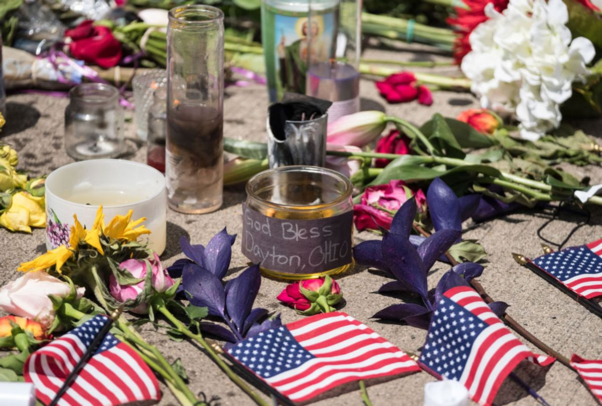 Candles and flowers a placed in front of Ned Peppers bar after the mass shooting over the weekend in Dayton, Ohio on August 5, 2019. (Getty/MEGAN JELINGER)