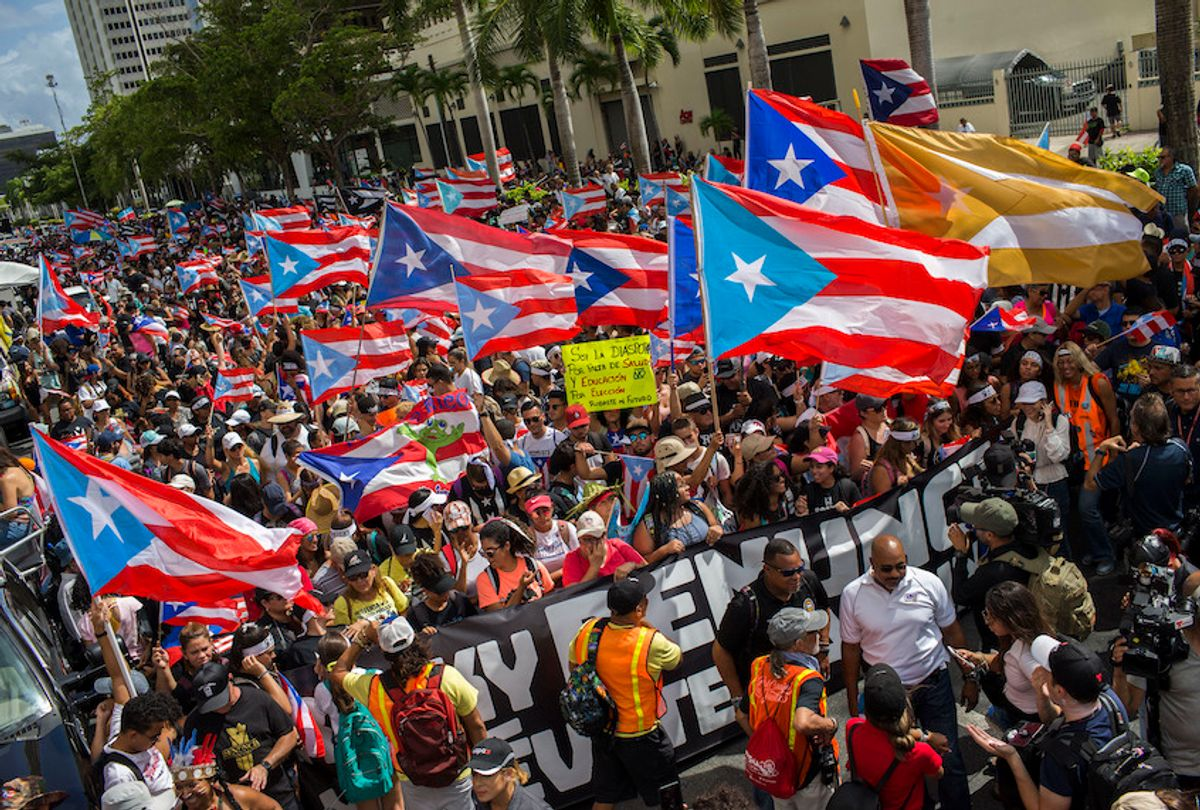 People gather to celebrate the resignation of Gov. Ricardo Rossello who announced that he is resigning Aug. 2 after weeks of protests in San Juan, Puerto Rico, Thursday, July 25, 2019. (AP Photo/Dennis M. Rivera Pichardo) (AP Photo/Dennis M. Rivera Pichardo)