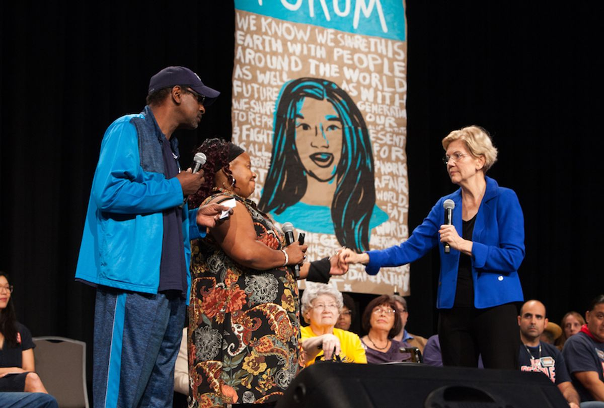 Elizabeth Warren with Chris Robinson (left) and Laural Clinton of the Iowa CCI Action Fund (Karla Conrad)
