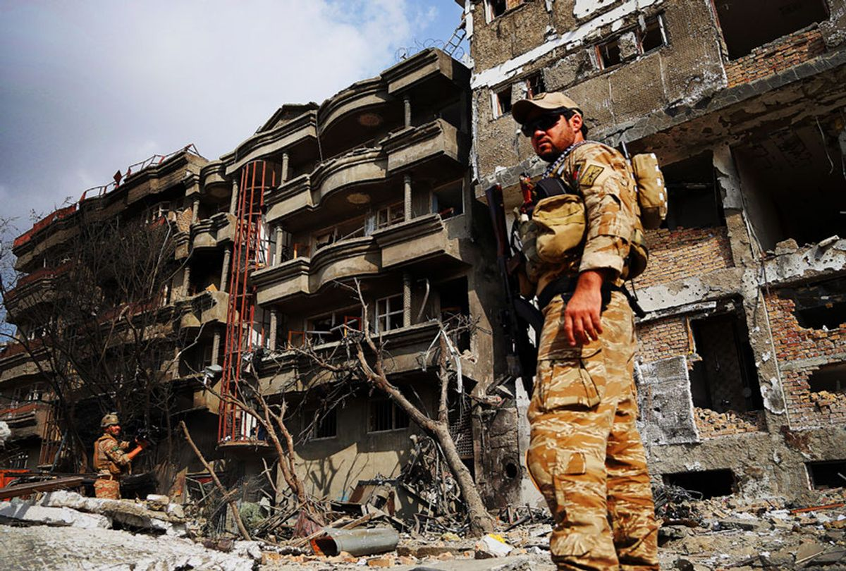 Afghan security forces inspect the aftermath of Sunday's attack in Kabul, Afghanistan, Monday, July 29, 2019. (AP Photo/Rahmat Gul)