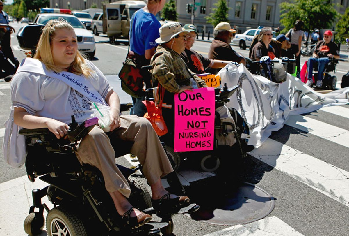 Protestors from ADAPT, a grass-roots community that organizes disability rights activists to engage in nonviolent direct action, block the intersection of 15th Street and Pennsylvania Avenue NW near the White House for nearly four hours September 20, 2010 in Washington, DC. (Chip Somodevilla/Getty Images)