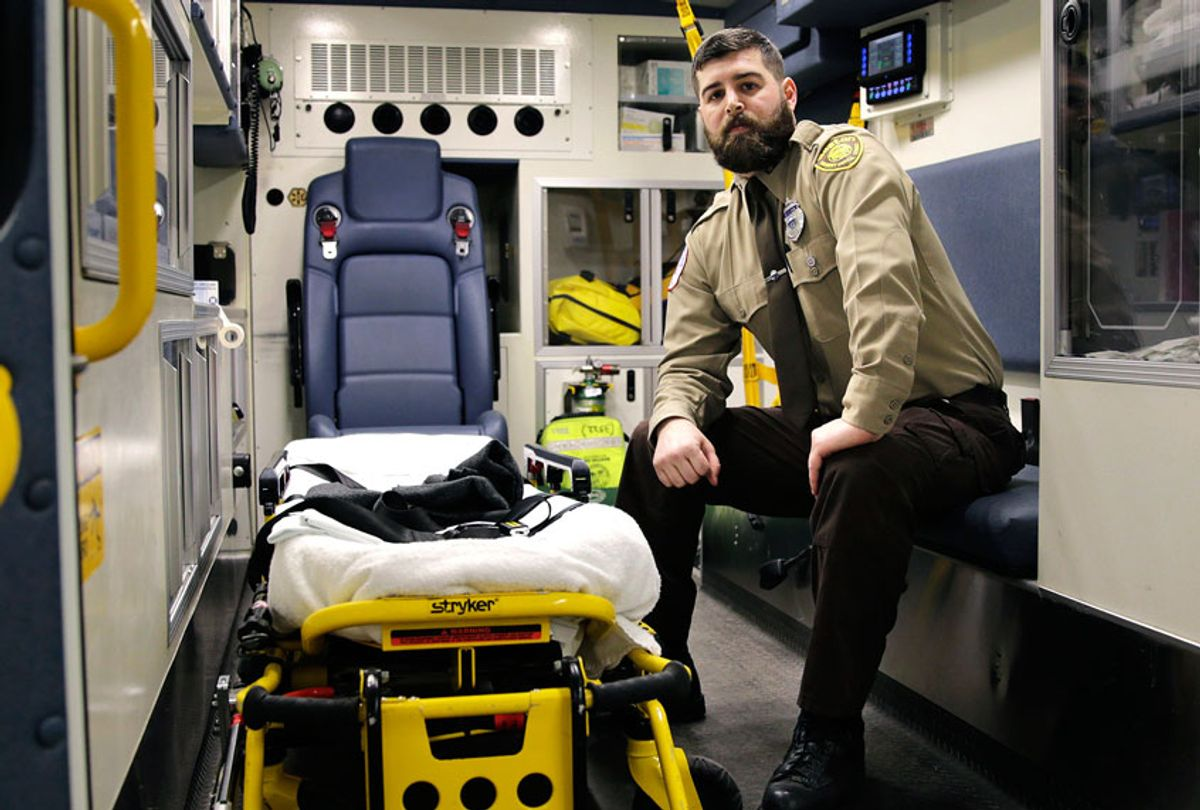 Boston Emergency Medical Services EMT Paul Mitchell sits in an ambulance at his station in the Hyde Park neighborhood of Boston. Mitchell, with bystander Carlos Arredondo and volunteer Devin Wang, are credited with helping to save the life of Jeff Bauman, who suffered traumatic injuries in the Boston Marathon bombings. (AP Photo/Charles Krupa)