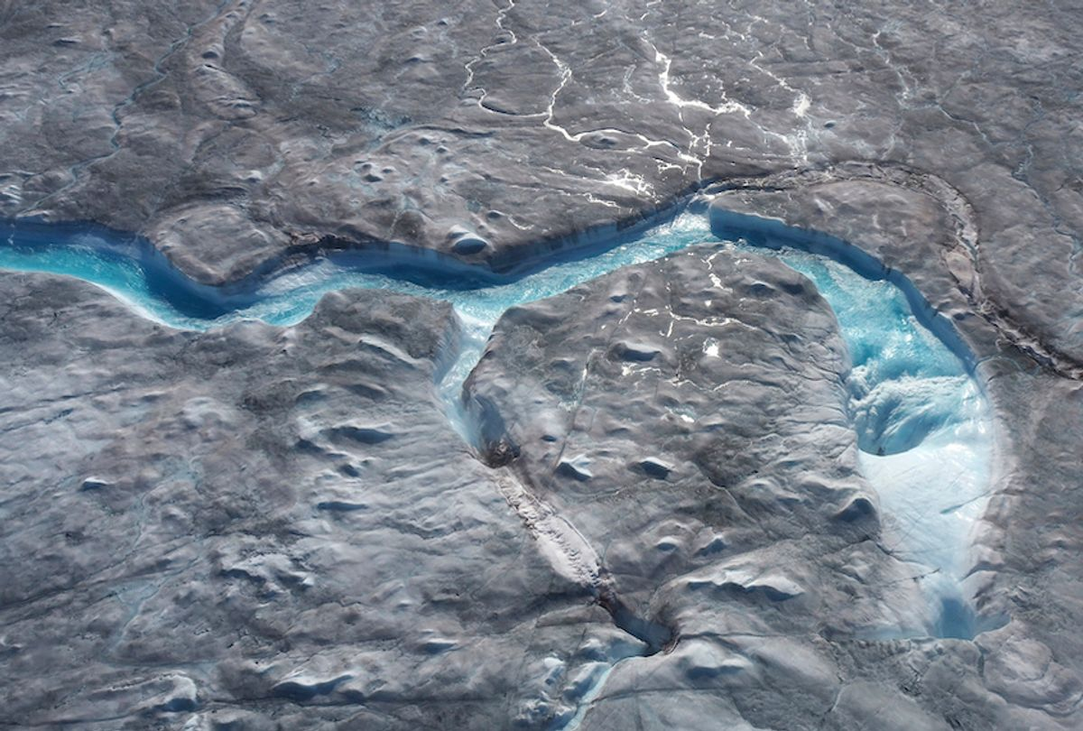 In this image taken on Thursday Aug.1, 2019 large rivers of melting water form on an ice sheet in western Greenland and drain into moulin holes that empty into the ocean from underneath the ice.  (Photo via Caspar Haarløv, Into the Ice via AP)