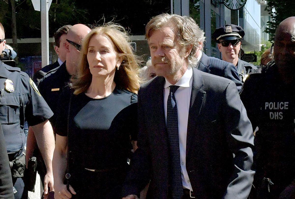 Felicity Huffman and husband William Macy arrive at John Moakley U.S. Courthousefor Huffman's sentencing hearing for her role in the college admissions scandal on September 13, 2019 in Boston, Massachusetts.  (Paul Marotta/Getty Images)