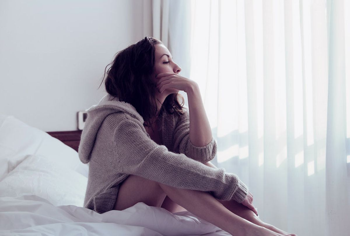 Pensive woman in bed (Getty/A75)