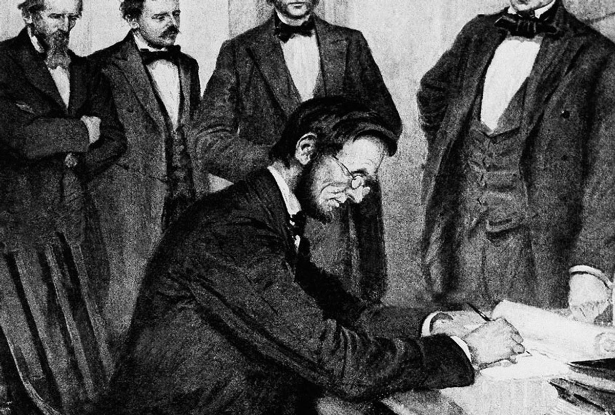 President Abraham Lincoln signs the Emancipation Proclamation, Jan. 1, 1863, in Washington. (AP Photo)