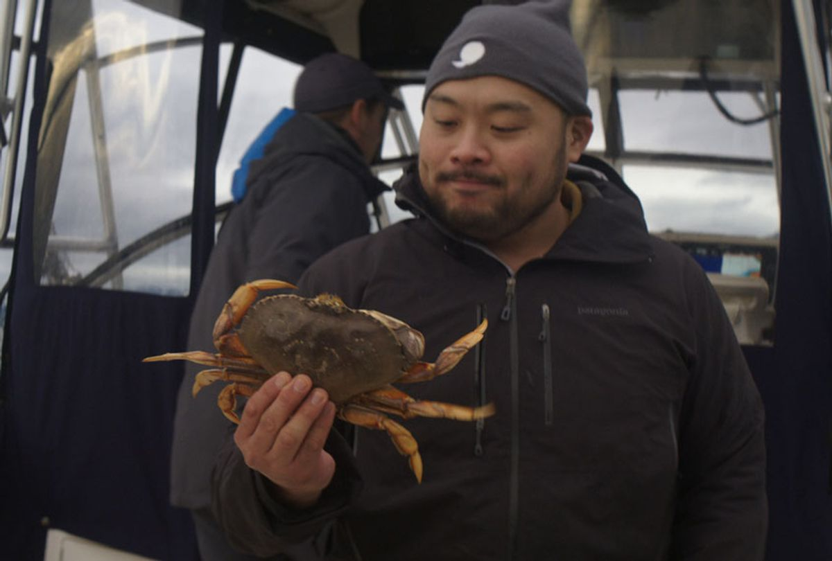Breakfast, Lunch, & Dinner - Season 1 David Chang evaluating a fresh caught crab while fishing in Vancouver (Netflix)