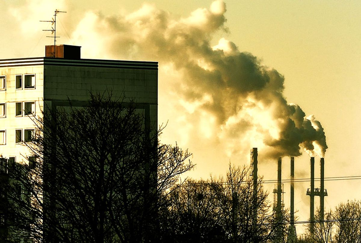 Smoke rises from factory stacks in Santes, near Lille, on January 22, 2013.  (PHILIPPE HUGUEN/AFP/Getty Images)