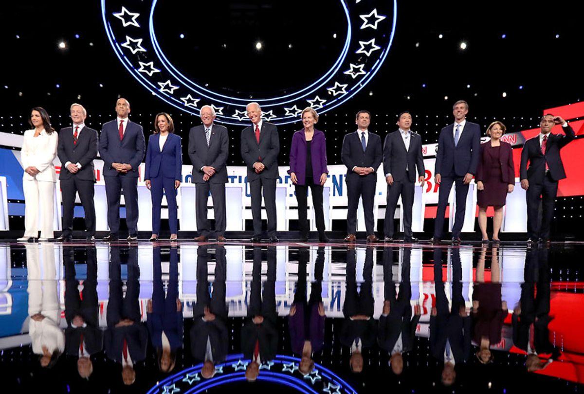 Democratic presidential candidates (L-R) Rep. Tulsi Gabbard (D-HI), billionaire Tom Steyer, Sen. Cory Booker (D-NJ), Sen. Kamala Harris (D-CA), Sen. Bernie Sanders (I-VT), former Vice President Joe Biden, Sen. Elizabeth Warren (D-MA), South Bend, Indiana Mayor Pete Buttigieg, former tech executive Andrew Yang, former Texas congressman Beto O'Rourke, Sen. Amy Klobuchar (D-MN), and former housing secretary Julian Castro at the strart of the Democratic Presidential Debate at Otterbein University on October 15, 2019 in Westerville, Ohio. A record 12 presidential hopefuls are participating in the debate hosted by CNN and The New York Times. (Chip Somodevilla/Getty Images)