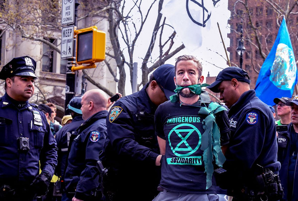 People are detained while participating in a direct action with a group protest organization called Extinction Rebellion on April 17, 2019 in New York City. The activists are demanding governments declare a climate emergency to combat pollution.  (Stephanie Keith/Getty Images)